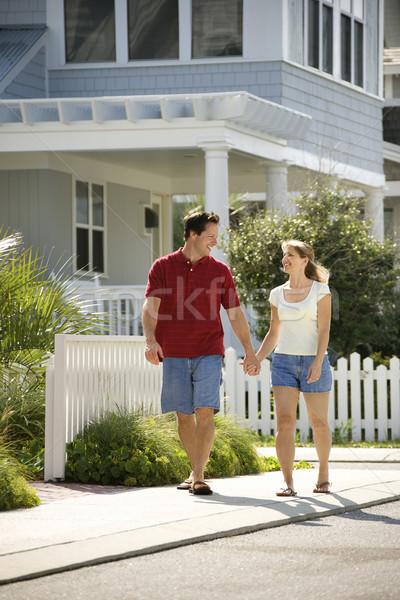 Couple walking on sidewalk. Stock photo © iofoto