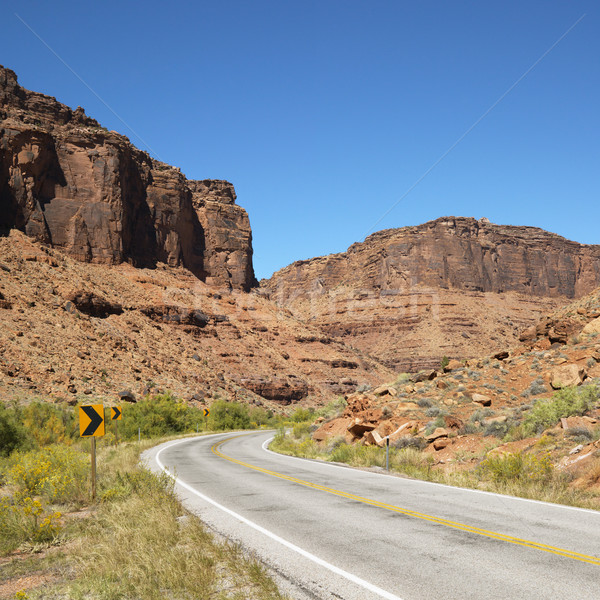 Curved road with rock cliffs. Stock photo © iofoto