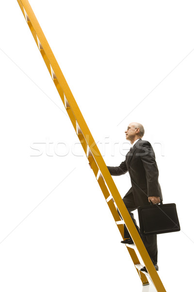Businessman climbing ladder. Stock photo © iofoto