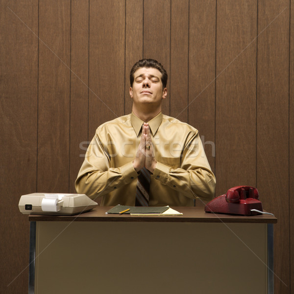 Praying businessman. Stock photo © iofoto
