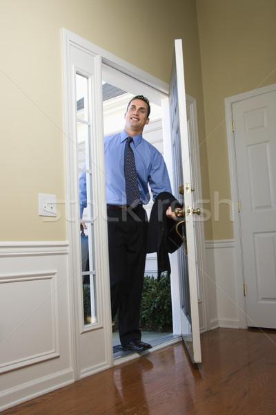 Businessman coming home. Stock photo © iofoto
