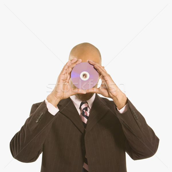 Férfi tart CD afroamerikai arc üzlet Stock fotó © iofoto
