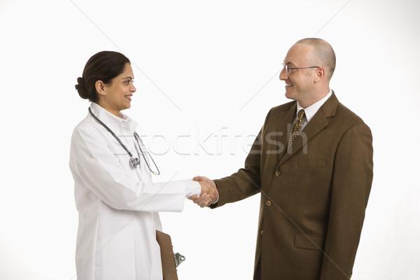 ストックフォト: 女性 · 医師 · ビジネスマン · インド · 成人 · 握手