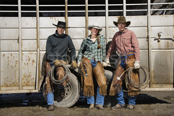 Young Woman Standing Next to Two Men with Lariats Stock photo © iofoto