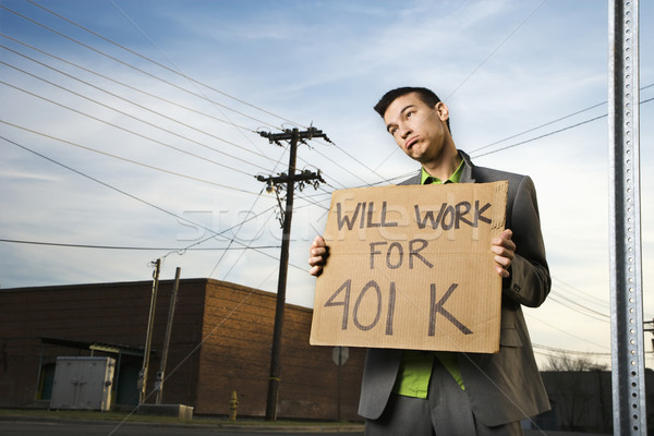 Young Businessman Holding 401k Sign Stock photo © iofoto
