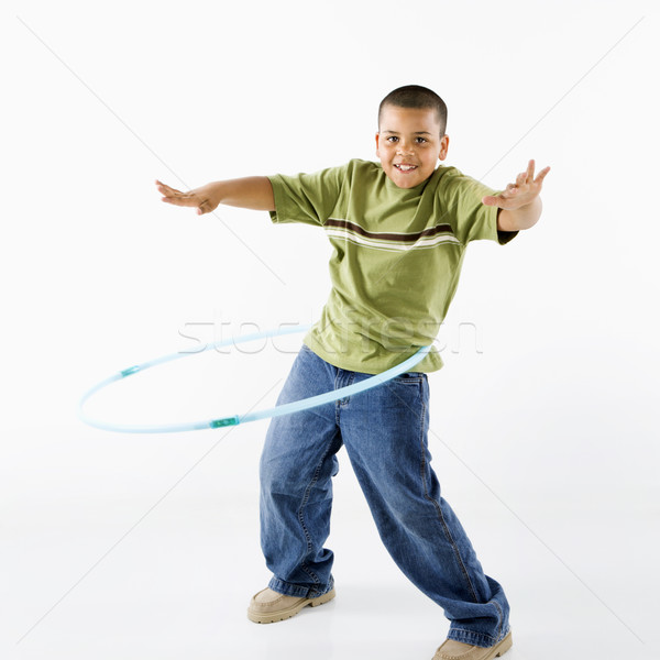 Boy using hula hoop. Stock photo © iofoto