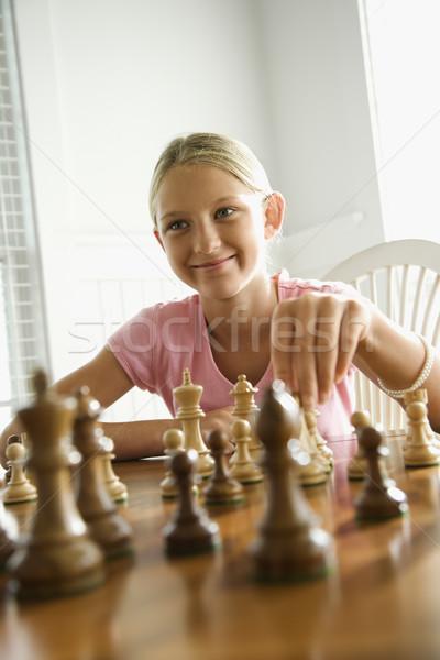 Ragazza giocare scacchi sorridere bambino Foto d'archivio © iofoto