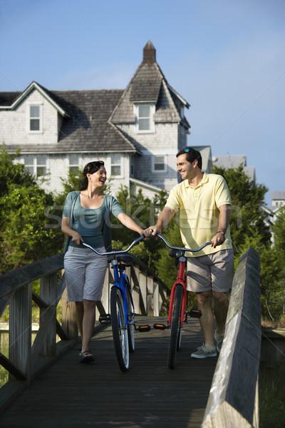 Couple on Bridge with Bicycles Stock photo © iofoto