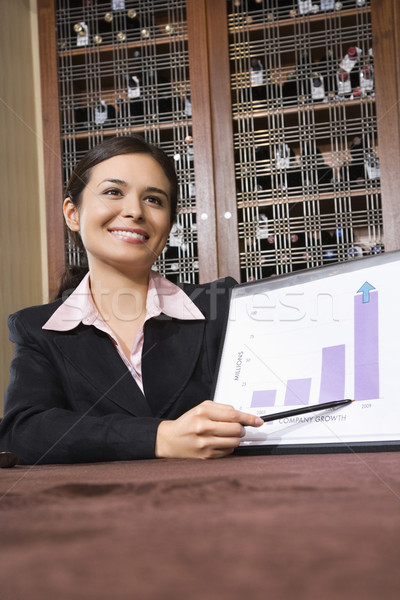 Businesswoman with bar graph. Stock photo © iofoto