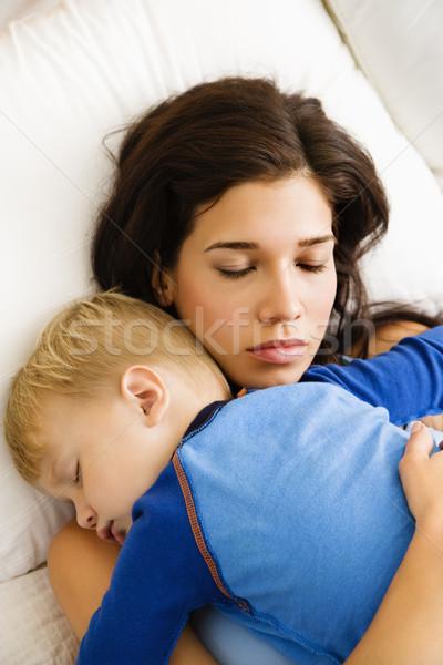 Stock photo: Mom and child sleeping.