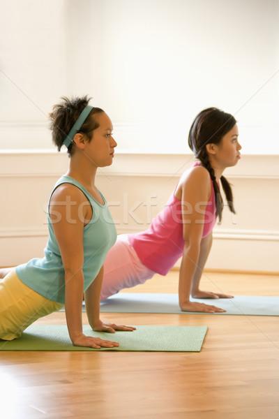 Women doing yoga Stock photo © iofoto