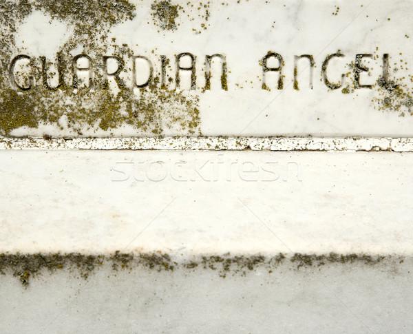 Pedra guardião anjo lápide palavras fundo Foto stock © iofoto