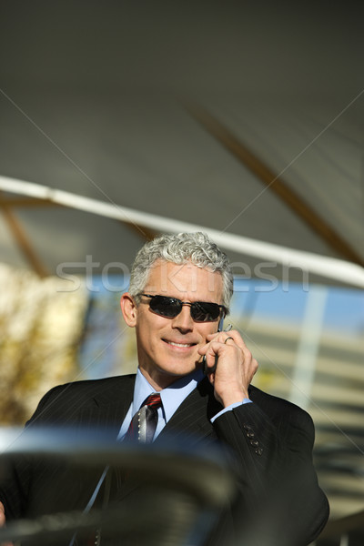 Businessman with cellphone. Stock photo © iofoto