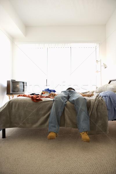 Adam yatak düşük vücut dikey atış Stok fotoğraf © iofoto