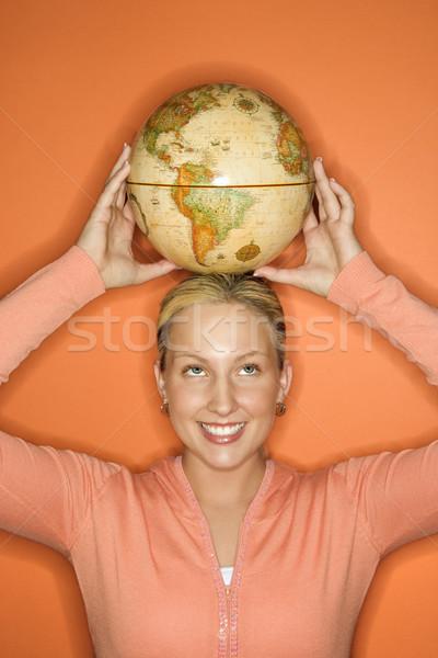 Girl balancing globe. Stock photo © iofoto
