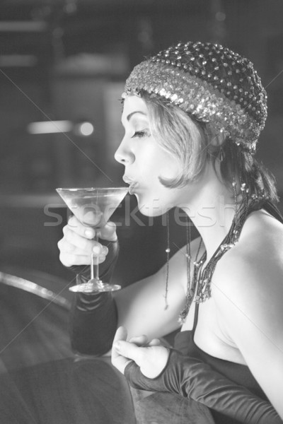 Retro woman drinking martini. Stock photo © iofoto