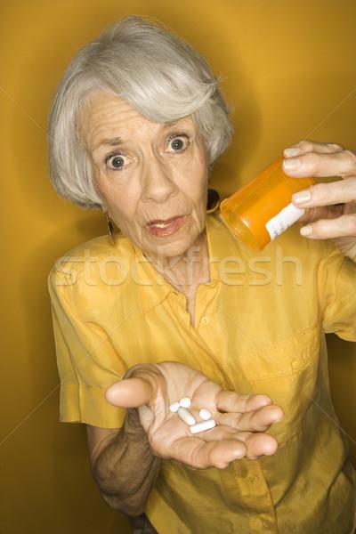 Woman with medication. Stock photo © iofoto