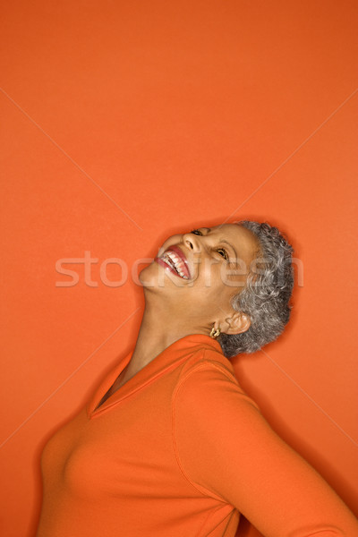 Woman with head back smiling. Stock photo © iofoto
