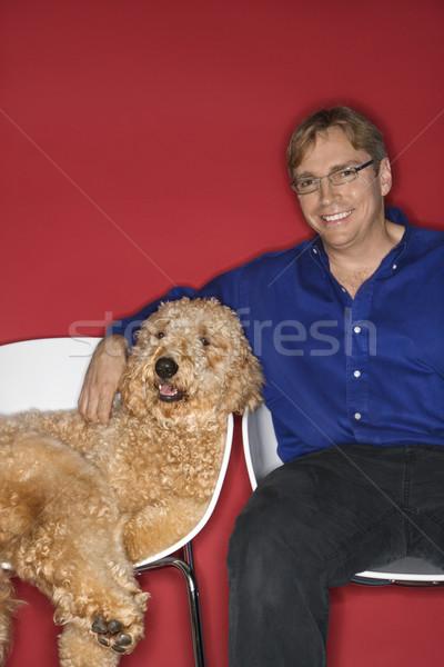 Homme chien couleur studio Photo stock © iofoto