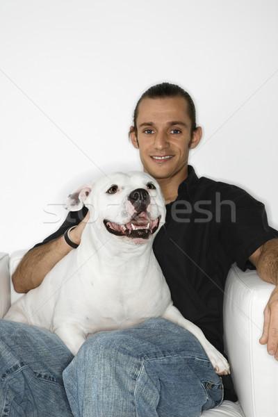Man holding white dog. Stock photo © iofoto
