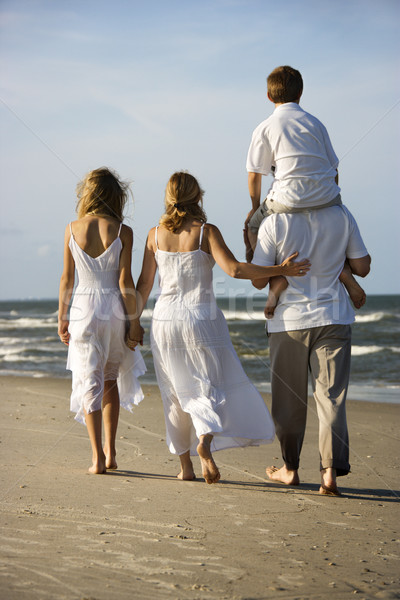 Family walking down beach. Stock photo © iofoto