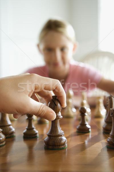 Sakk játék kaukázusi kéz mozog sakkfigura Stock fotó © iofoto