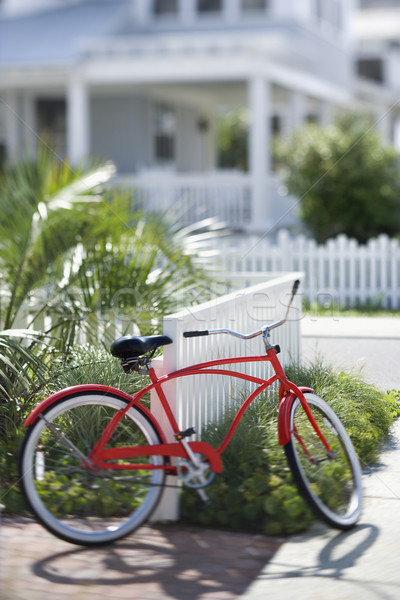 Red bicycle in front of house. Stock photo © iofoto