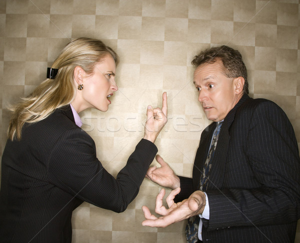 Businesswoman Flipping off Businessman Stock photo © iofoto