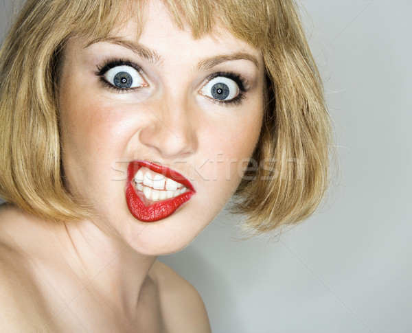 Stock photo: Woman looking crazy.