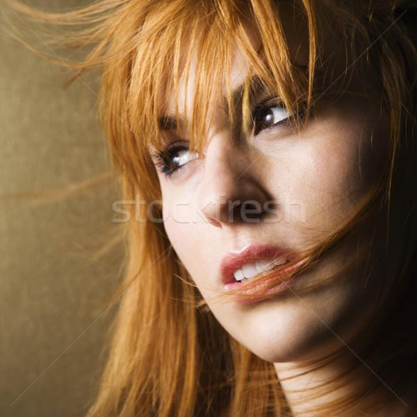 Windblown woman looking to side Stock photo © iofoto