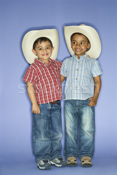 Boys in cowboy hats. Stock photo © iofoto