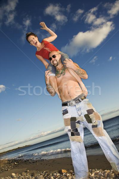 Couple playing on beach. Stock photo © iofoto