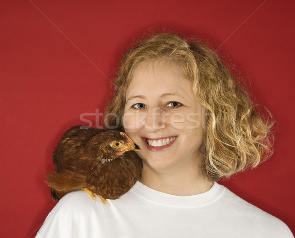 Woman with chicken on shoulder. Stock photo © iofoto