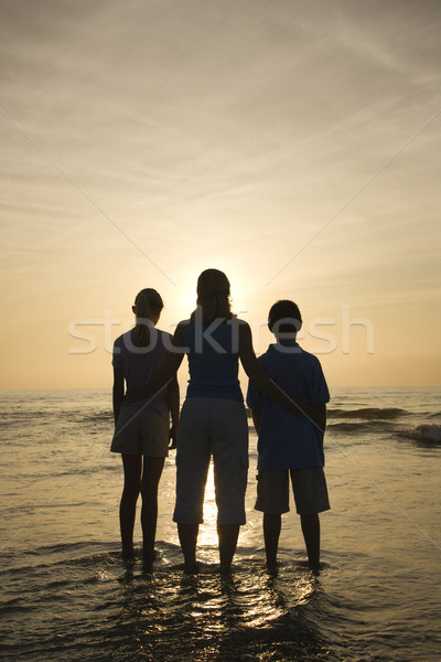 Stock photo: Mom and kids at beach.