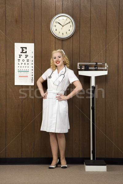 Retro infermiera femminile mani fianchi Foto d'archivio © iofoto