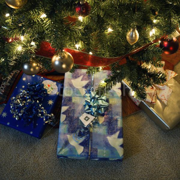 Stock photo: Christmas presents under tree.