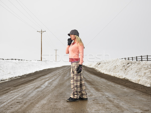 Nő mobiltelefon fiatal nő tél ruházat áll Stock fotó © iofoto