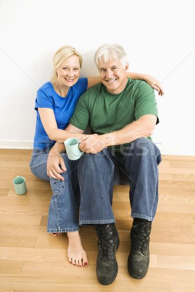 Homme femme séance ensemble couple Photo stock © iofoto