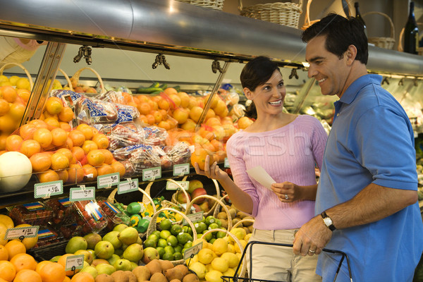 Couple épicerie Shopping fruits regarder Photo stock © iofoto