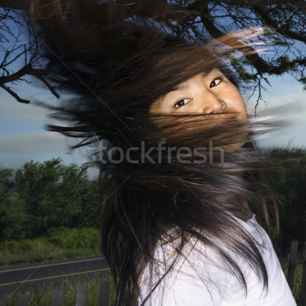 Woman swinging hair. Stock photo © iofoto