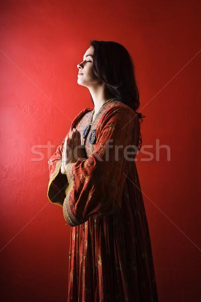 Fiatal nő imádkozik izolált vonzó áll piros Stock fotó © iofoto