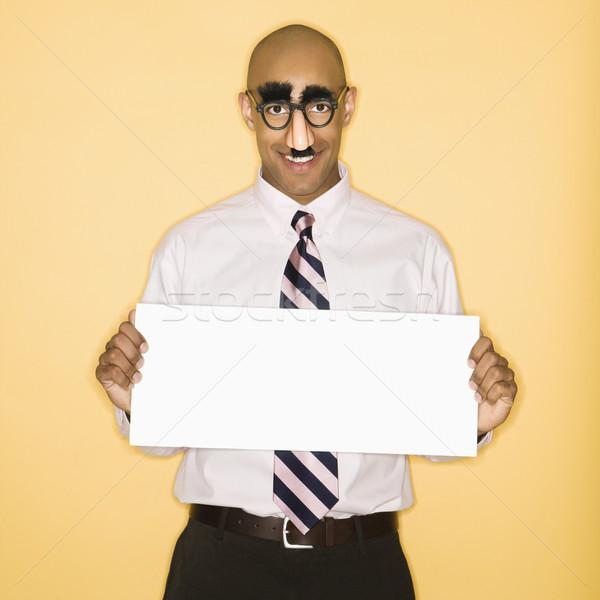 Man holding  blank sign. Stock photo © iofoto