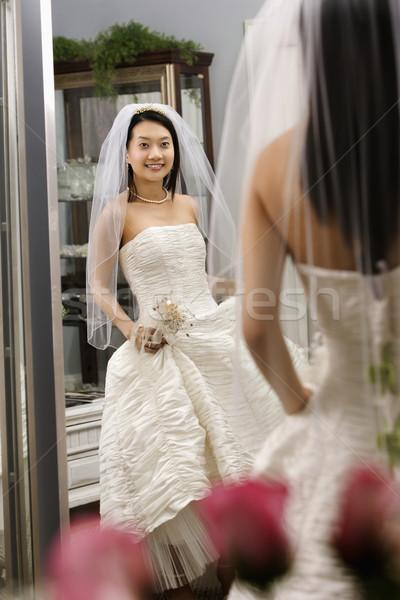 Bride admiring dress.  Stock photo © iofoto