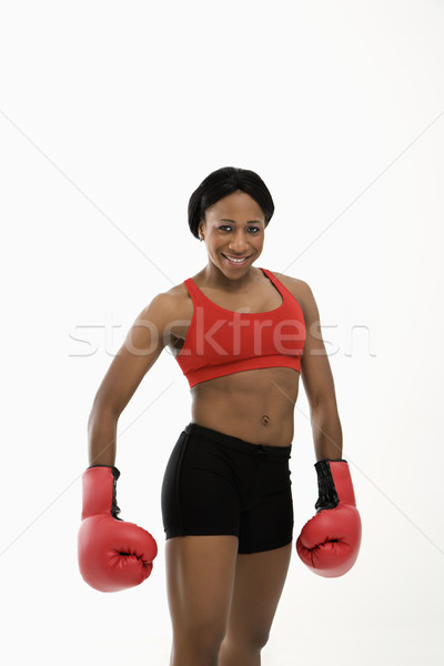 Woman wearing boxing gloves. Stock photo © iofoto