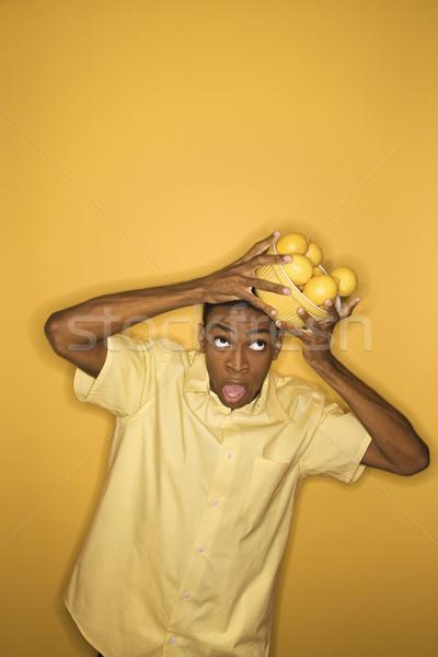 Man dropping lemons. Stock photo © iofoto