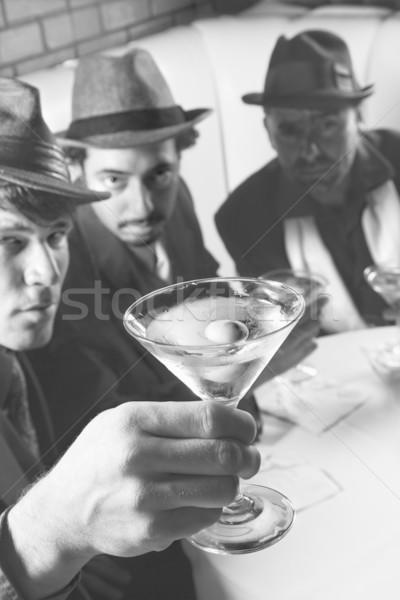 Retro men drinking martinis. Stock photo © iofoto