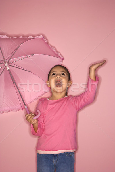 Cute Latina girl holding umbrella. Stock photo © iofoto