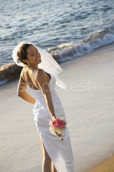 Bride standing on beach. Stock photo © iofoto