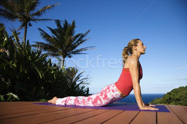 Genç kadın yoga çekici kırmızı güverte okyanus Stok fotoğraf © iofoto