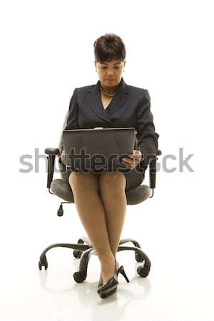 Businesswoman with laptop. Stock photo © iofoto